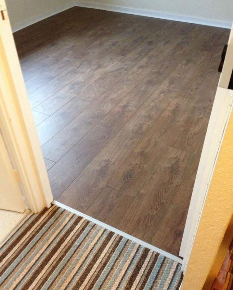 Awesome laminate flooring derby ideas flooring area for Rugs for laminate floors